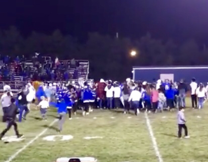 Lyons crowd celebrates with team on field after win